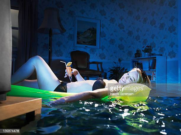 young woman sunbading in flooded room