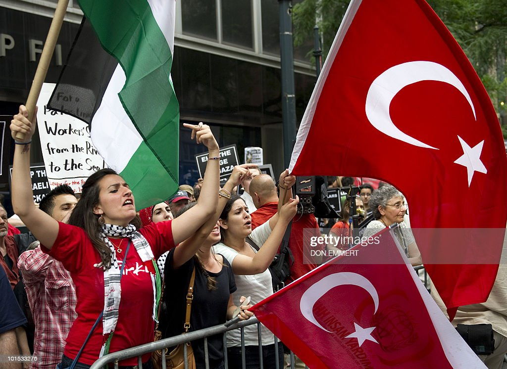 A young woman, supporting Palestine, flashes a gesture toward another young woman carrying an Israeli flag on June 1, 2010 in New York during a protest against an Israeli raid on a Gaza-bound aid flotilla.