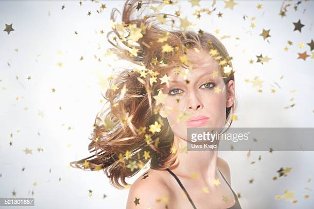 Young woman surrounded by sparkling stars