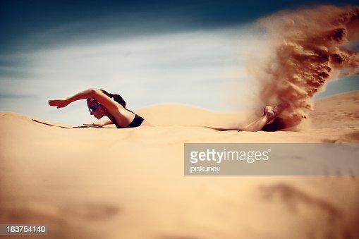 Young woman swim in desert : Stock Photo