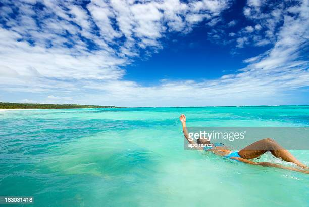 Young Woman Swimming Backwards in Tropical Ocean