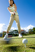 Young Woman Swinging a Club, Blurred Motion