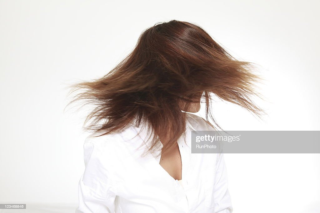 young woman swinging hair : Stock Photo