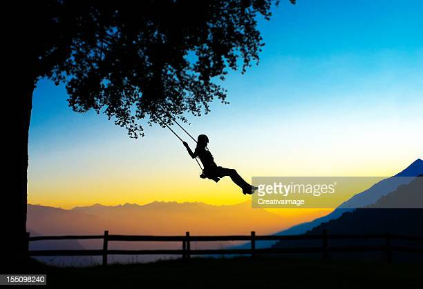Young Woman Swinging silhouette