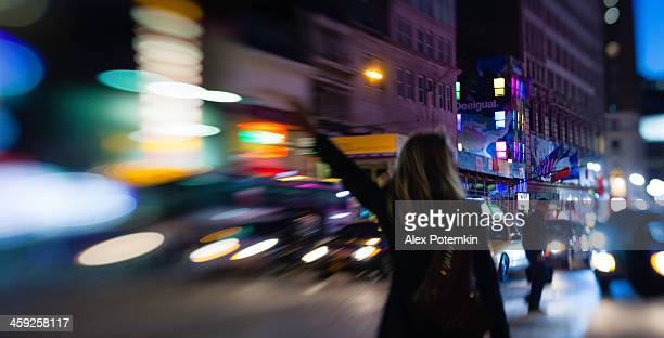 Young woman take a taxi in NY