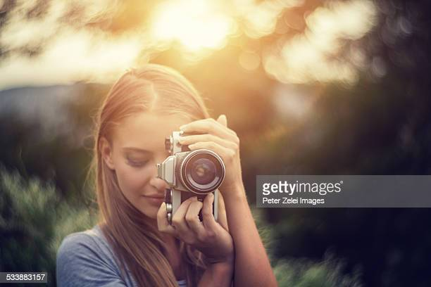 Young woman takes a photo