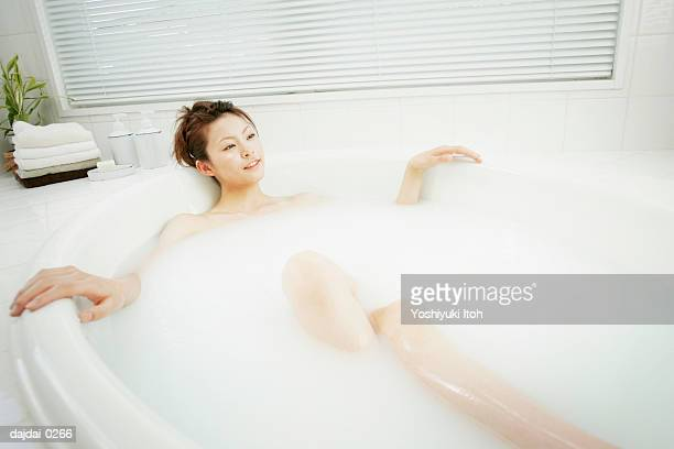 Young Woman Taking a Bath