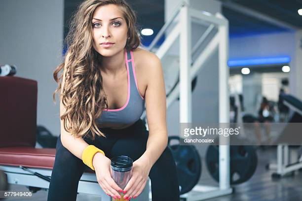 Young woman taking a break at the gym
