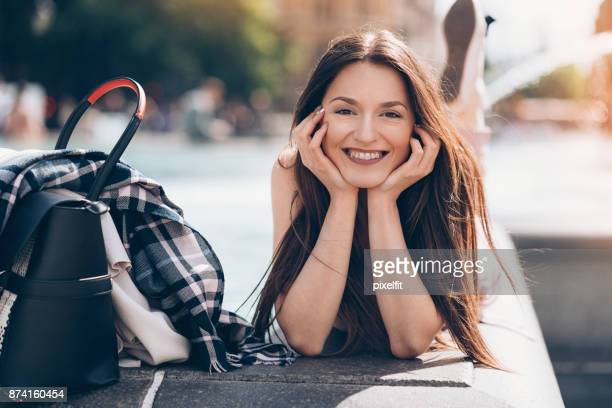 Young woman taking a break outdoors in the city