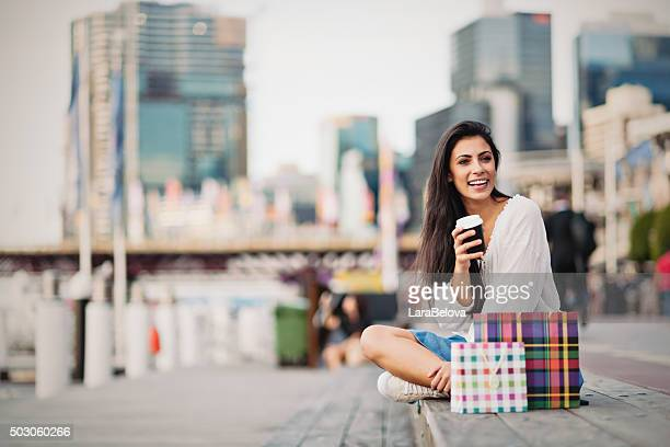 Young woman taking a coffee break, Sydney