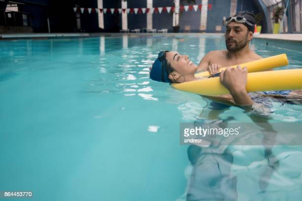 Young woman taking a swimming lessons