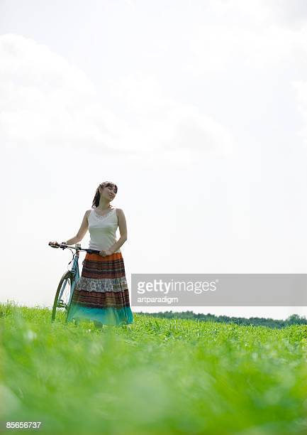 Young woman taking a walk on grass