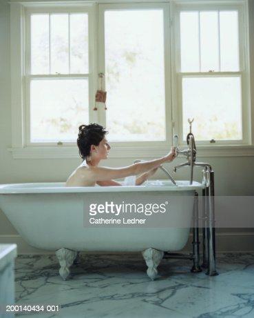 Young woman taking bath : Stock Photo