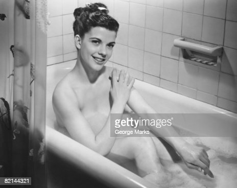 Young woman taking bath   B W   portrait   Stock Photo. Young Woman Taking Bath Portrait Stock Photo   Getty Images