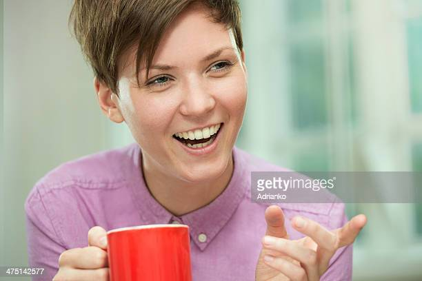 Young woman taking coffee break