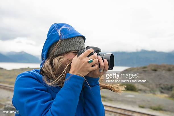 Young Woman taking photo in Alaska