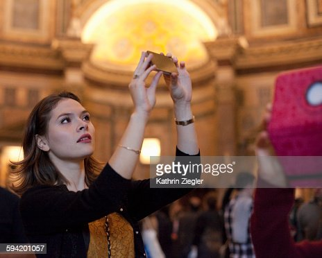 young woman taking pictures at the Pantheon, Rome : Stock Photo
