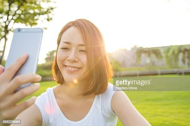 Young woman taking selfie portrait