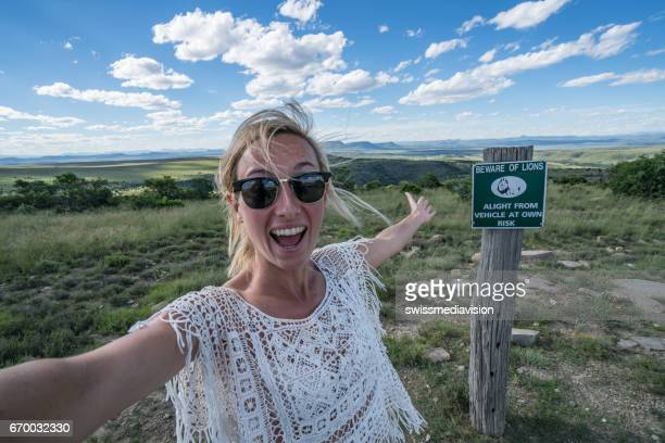Young woman taking selfie with mountain landscape