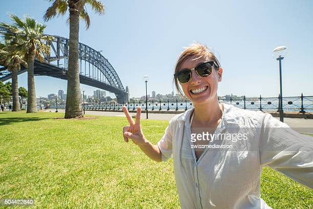Young woman tales selfie portrait with Sydney harbour bridge