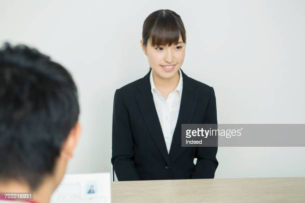 Young woman talking in job interview