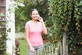 Young woman talking on her cell phone outdoors