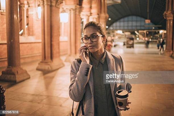 young woman talking on her phone after work
