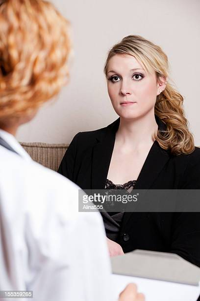 Young woman talking to a therapist
