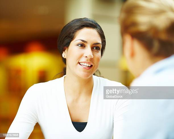 Young woman talking to her friend