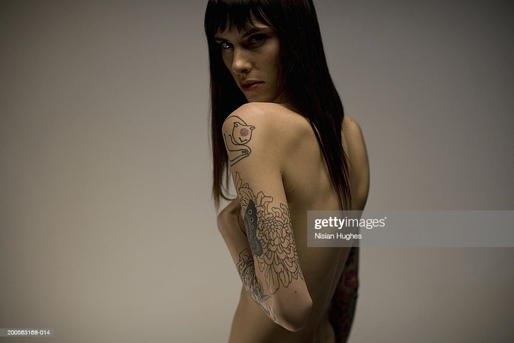 Young woman tattoo on arm, portrait : Stock Photo