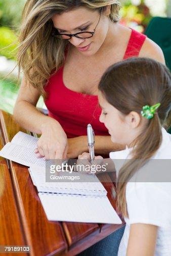 Young woman teaching a girl : Stock Photo