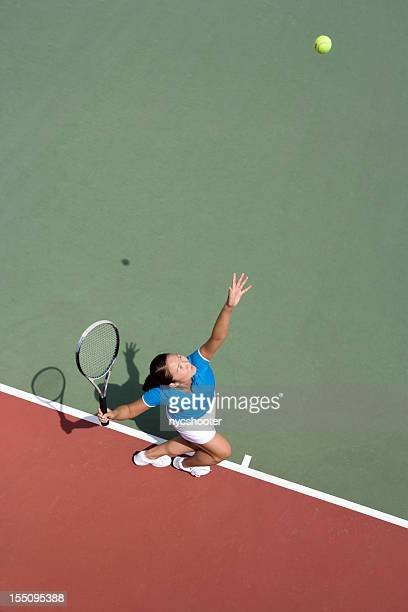 Young woman tennis player serving
