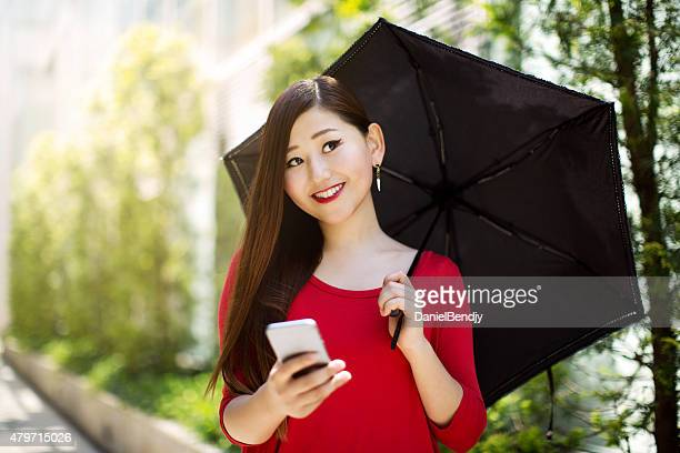 Young Woman Texting On Phone