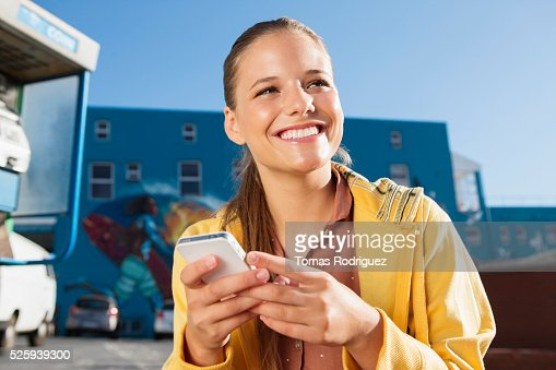 Young woman texting on smartphone : Stock Photo