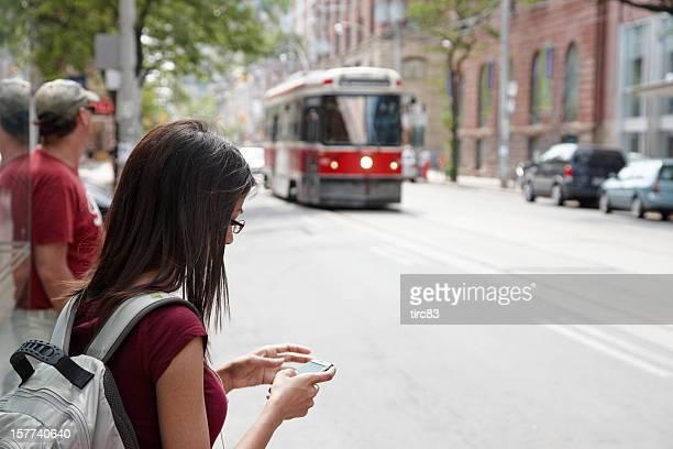 Young woman texting on Toronto street