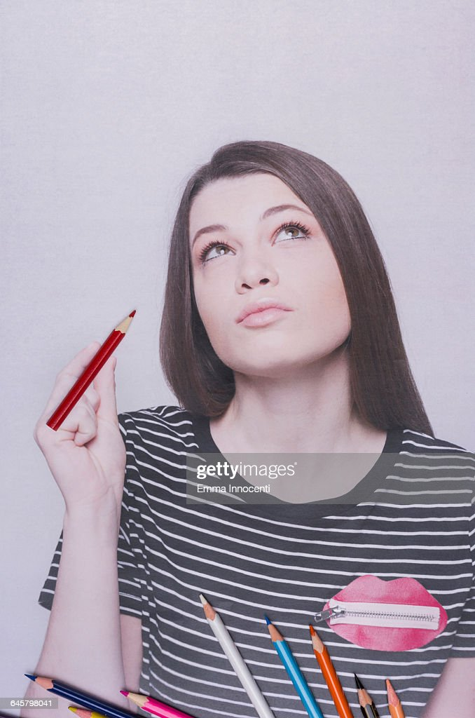 Young woman thinking about drawing
