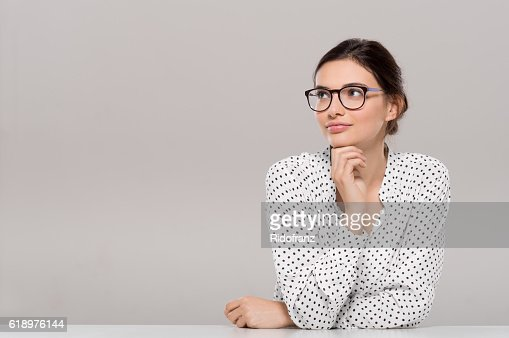 Young woman thinking : Stock Photo
