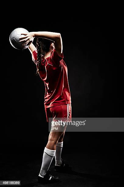 Young woman throwing football
