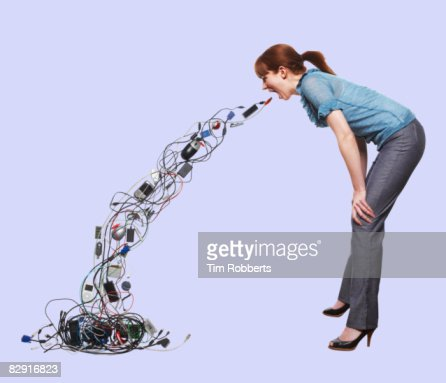 Young woman throwing up electrical items