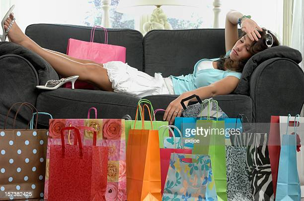 young woman tired after shopping