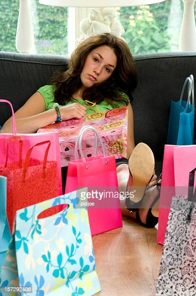 young woman tired of shopping