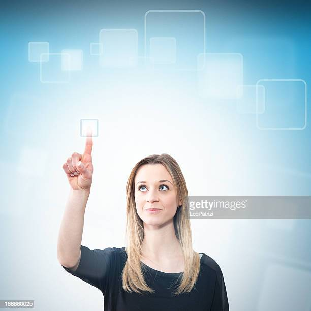 Young woman touching a futuristic screen