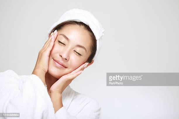 young woman touching face,skin care