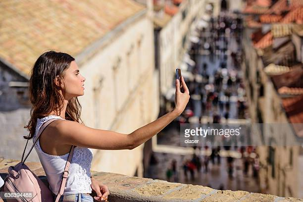 Young woman tourist Dubrovnik, taking selfie