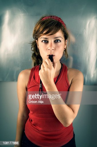 Young Woman Trainer Blowing Whistle