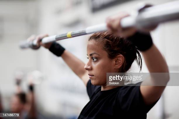 Young woman training in fitness center