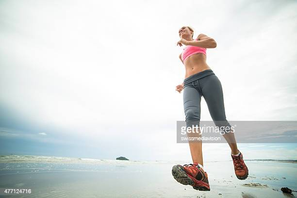 Young woman training on the beach