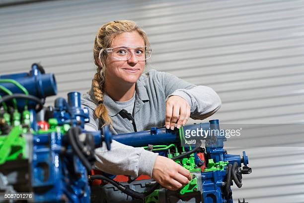 Young woman training to be auto mechanic