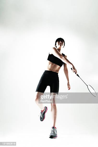young woman training,badminton