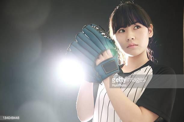 young woman training,baseball